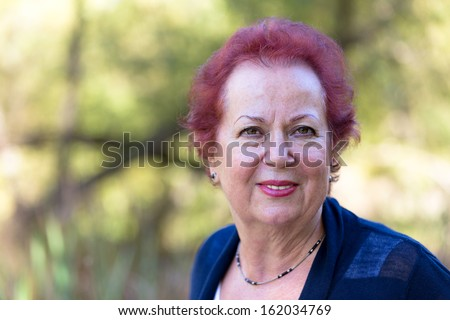 Senior Woman Looking at You Trustfully and Determined - stock photo