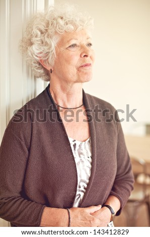 Senior woman looking away and thinking about something - stock photo