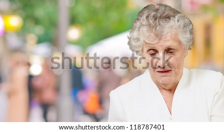 Senior woman looking down, outdoor