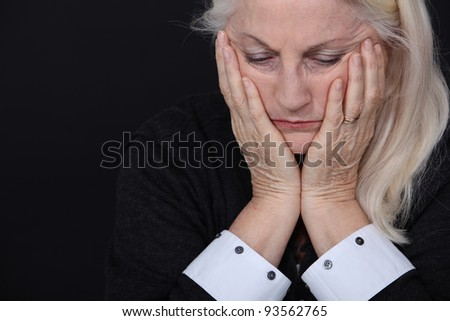 senior woman looking sad and lonely - stock photo