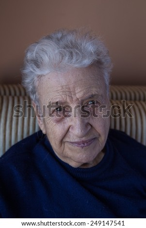 senior woman looking to the camera - stock photo