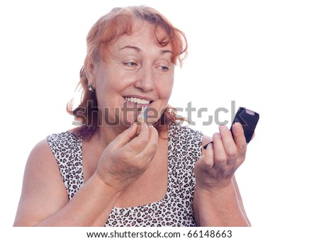 Senior woman makes makeup - stock photo