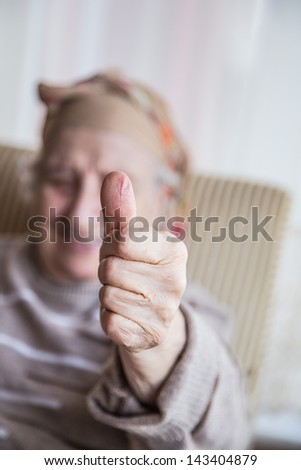 senior woman making okay sign with her finger - stock photo
