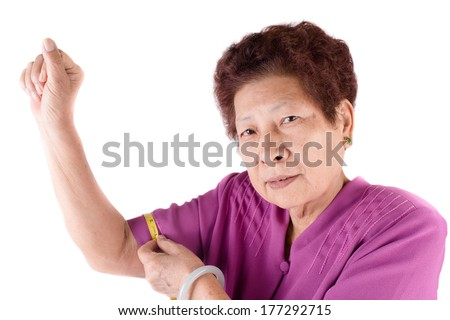 Senior woman measuring her waist by centimeter - stock photo