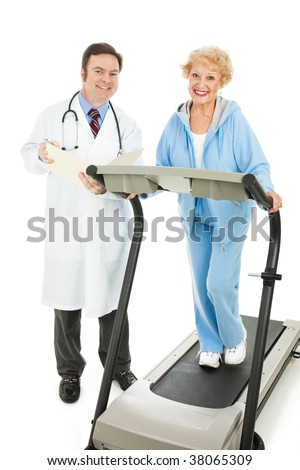 Senior woman on a treadmill being evaluated by her doctor.  Isolated on white. - stock photo