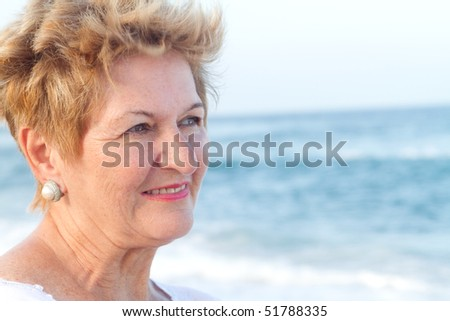 senior woman on beach - stock photo