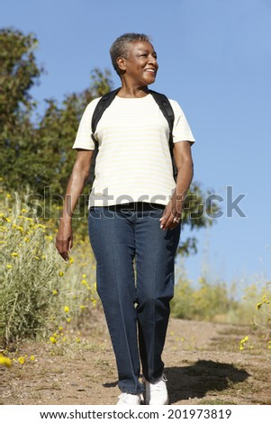Senior  woman on country hike