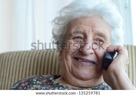 senior woman on phone - stock photo