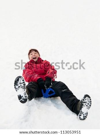 Senior woman on sleigh - winter snow activity - stock photo