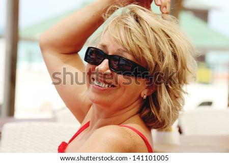 senior woman on summer vacation at sea - stock photo