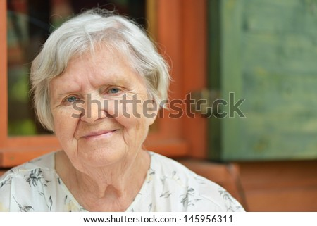 Senior woman on the veranda of his home. MANY OTHER PHOTOS FROM THIS SERIES IN MY PORTFOLIO.