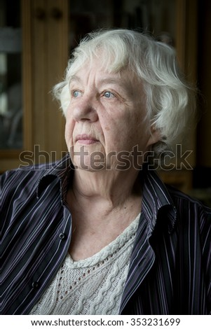 Senior woman pensive and worried. - stock photo