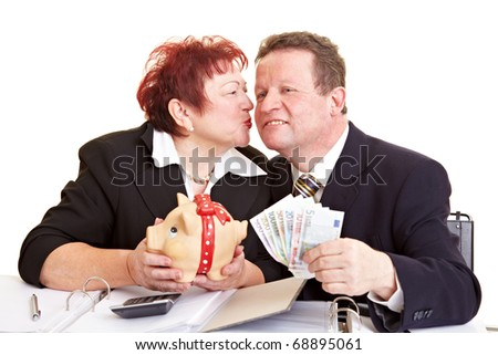Senior woman piggy bank kissing her husband who holds Euro banknotes - stock photo
