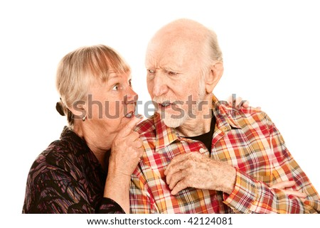Senior woman pointing her finger and husband - stock photo