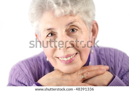 Senior woman portrait, close-up,with white hair and violet pullover, hands under shin,isolated on white background - stock photo