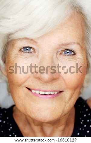 Senior woman portrait, closeup, looking  happy - stock photo