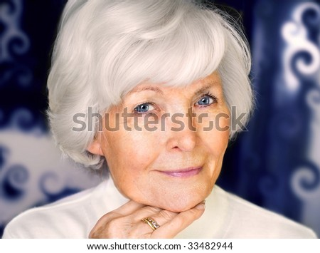 Senior woman portrait,  on  blue curly pattern background with white hair - stock photo