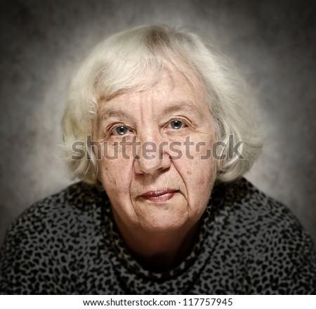 Senior woman portrait with white hair - stock photo