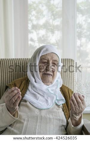 senior woman praying - stock photo
