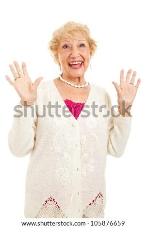 Senior woman raising her hands in praise, joy or surprise.  Isolated on white. - stock photo