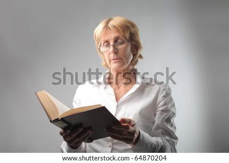 Senior woman reading a book - stock photo