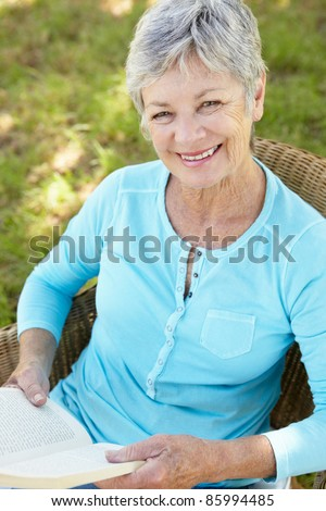 Senior woman reading a book - stock photo