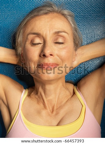Senior woman relaxing - stock photo