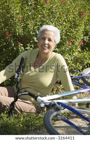 Senior woman relaxing after riding her bike