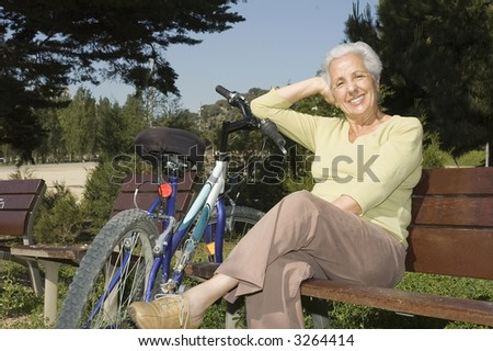 Senior woman relaxing after riding her bike - stock photo