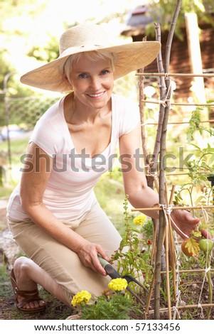 Senior Woman Relaxing In Garden - stock photo