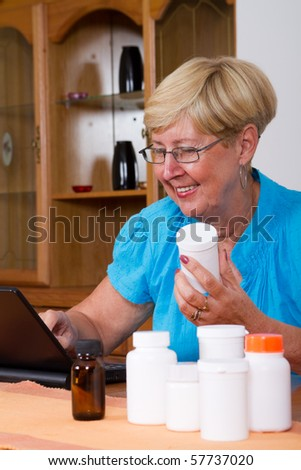 Senior woman researching and buying prescription medicines online - stock photo