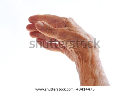Senior woman's hand isolated on white - stock photo
