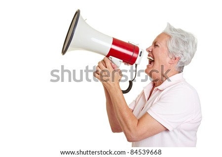 Senior woman screaming loudly in a megaphone - stock photo