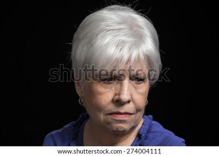 Senior woman seems worried - stock photo