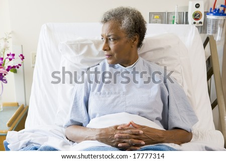 Senior Woman Sitting In Hospital Bed - stock photo