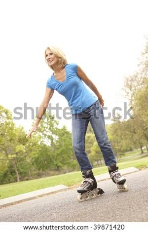 Senior Woman Skating In Park - stock photo
