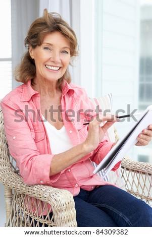 Senior woman sketching - stock photo