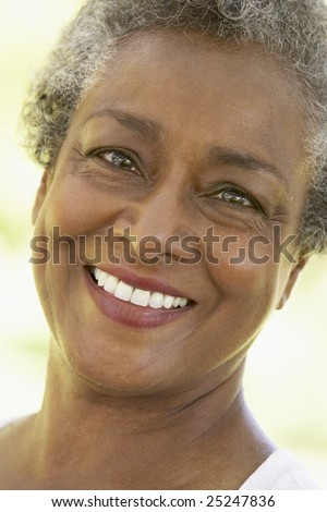 Senior Woman Smiling At The Camera - stock photo