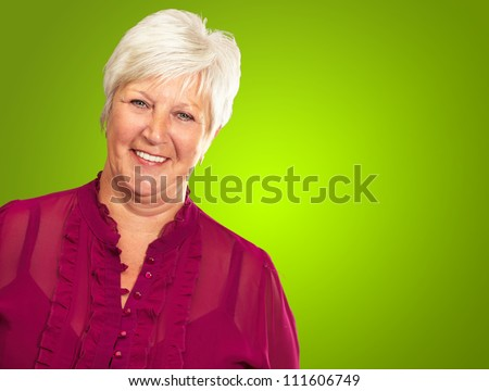 Senior Woman Smiling Isolated On Green Background - stock photo