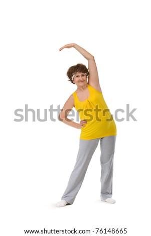 senior woman stretching making slope - stock photo