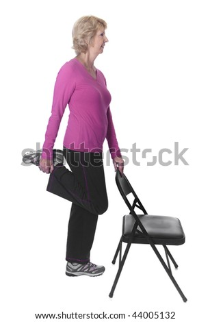 Senior woman stretching with chair - stock photo