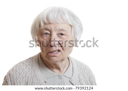 Senior woman studio portrait disappointed (Mouth lips side) - stock photo