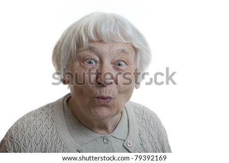 Senior woman studio portrait Happy surprised puckering