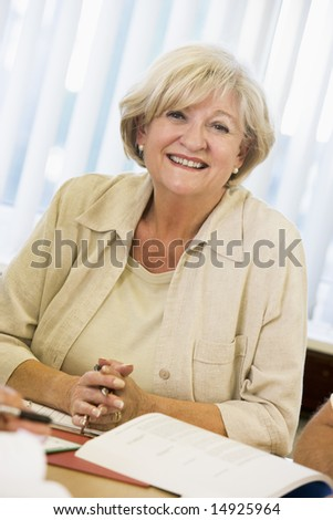 Senior woman studying on campus - stock photo
