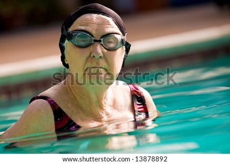 Senior Woman Swimming in Pool.