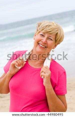 senior woman taking a break after doing exercise - stock photo