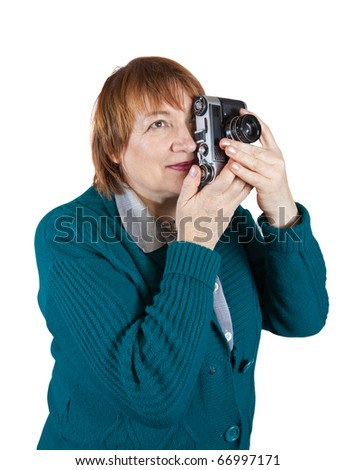 Senior woman taking photo with vintage camera