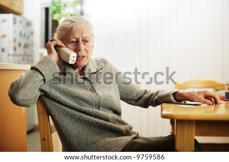 Senior woman talking on the phone - stock photo