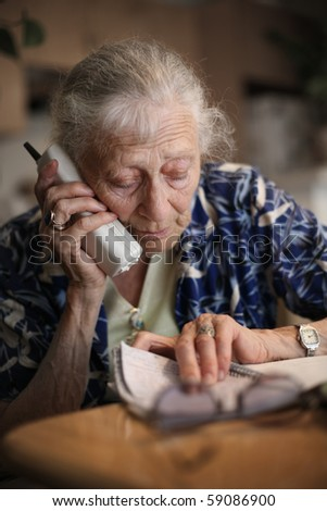 Senior woman talking on the phone. Close-up, shallow DOF. - stock photo