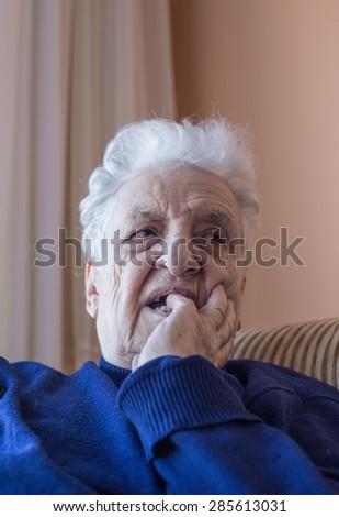 senior woman thinking - stock photo